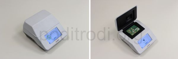 Fig.  4:  Photographs of the prototype of the PodiTrodi instrument closed (left) and open with the active microfluidic cartridge (right).